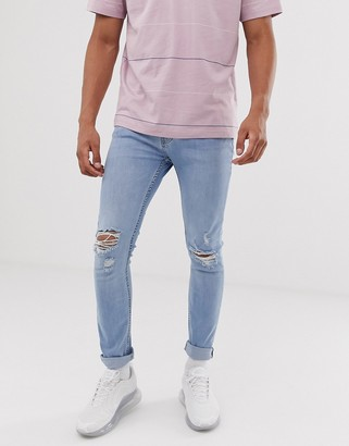 Topman super skinny jeans with rips in blue wash