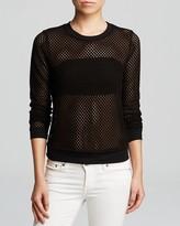 gwen stefani  Who made  Gwen Stefanis blue jeans, knit black top, black sandals, and silver clutch handbag?