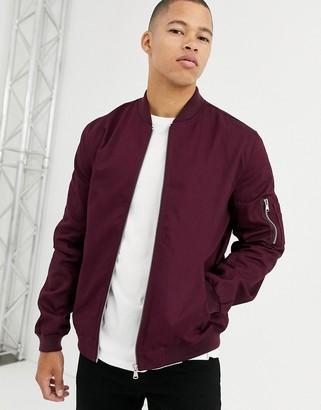 ASOS DESIGN bomber jacket with MA1 pocket in burgundy