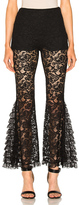 Givenchy Lace Flared Pants in Black.