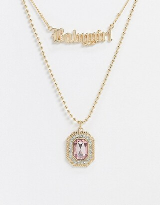 Asos Design DESIGN multirow necklace with babygirl gothic font and jewel pendant in gold tone