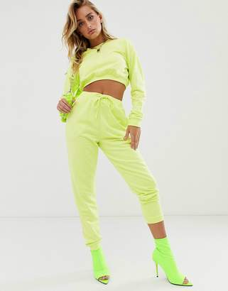 Asos Design DESIGN tracksuit cropped sweat / slim jogger with tie in neon yellow-Pink