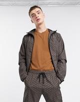 Criminal Damage nylon tracksuit jacket in black pattern