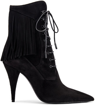 Saint Laurent Kiki Lace Up Fringe Ankle Booties in Black | FWRD