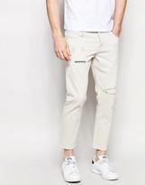 Asos Slim Jeans In Ecru With Raw Hem And Rip And Repair Details