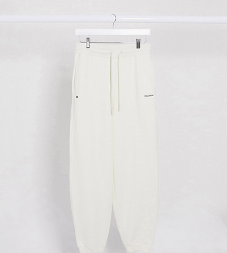 Collusion Unisex oversized joggers with text print in cream