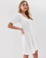 Asos Design DESIGN knot front button through sundress with puff sleeve
