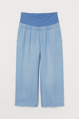 H&M MAMA Cropped lyocell trousers