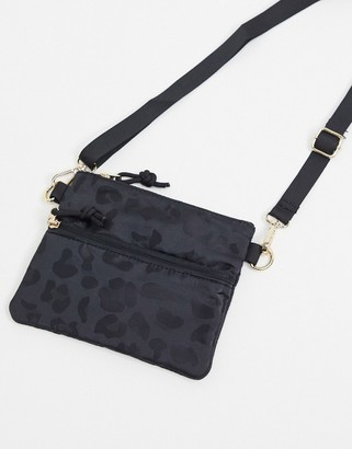 Pieces cross body zip bag with leopard print in black