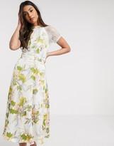 Liquorish a line lace detail midi dress in white floral print