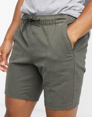 ASOS DESIGN skinny chino shorts with elastic waist in khaki