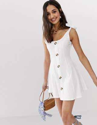 ASOS DESIGN mini button through slub sundress with tie shoulders