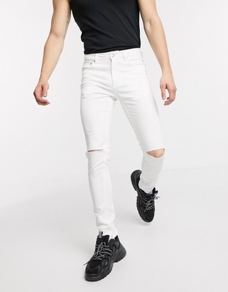 ASOS DESIGN super skinny denim jeans in white with knee rips