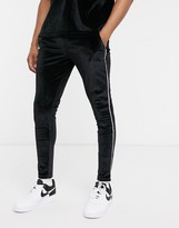 Asos Design DESIGN co-ord super skinny joggers in black velour with piping & fixed hem