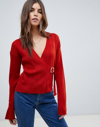 ASOS DESIGN wrap jumper in rib with buckle detail