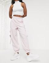 Asos Design DESIGN woven mix pocket jogger with buckle detail