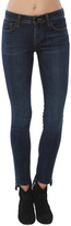 J Brand 811 Mid-Rise Staggered Skinny Jean