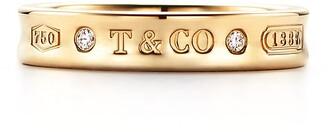 Tiffany & Co. 1837TM narrow ring in 18k gold with diamonds
