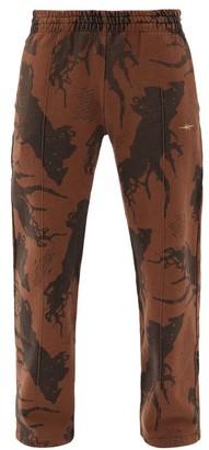 Phipps Tree-print Organic-cotton Jersey Track Pants - Brown