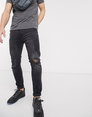 Topman organic skinny jeans with rips in washed black