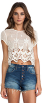 uncategorized  Who made Chloe Moretzs white cropped lace top that she wore in Los Angeles on August 27, 2014?