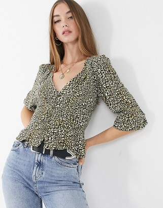 Stradivarius v-neck blouse in green animal print