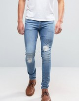 Asos Super Skinny Embroidered Jeans With Rips In Mid Wash