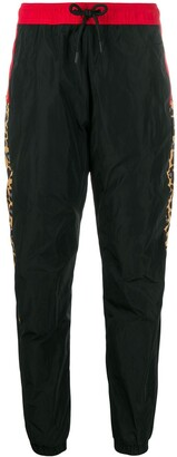 Marcelo Burlon County of Milan Leopard print track pants