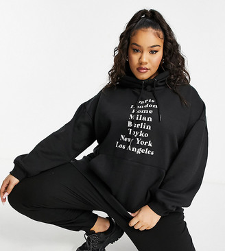 Lasula Plus oversized hoodie with city print in black