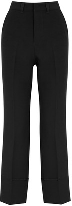 High Come-Along black flared-leg trousers