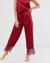 Loungeable burgundy satin pyjama pants with lace trim