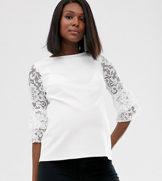 Blume Maternity exclusive lace sleeve top in white