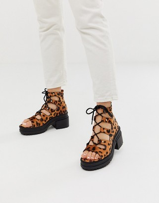 Asos DESIGN Sergio lace up mid heels in leopard