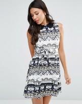 Yumi Belted Dress In Geometric Print