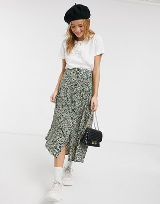 Asos DESIGN pleat front high waisted button through midi skirt in ditsy floral print