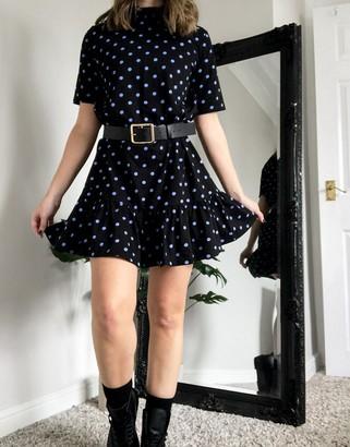 ASOS DESIGN mini short sleeve shirred detail high neck dress with pep hem in black and purple spot