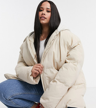 ASOS DESIGN Curve oversized jersey hooded puffer jacket in cream