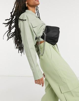 ASOS DESIGN nylon adjustable crossbody & shoulder bag in black with chain detail