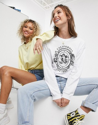 ASOS DESIGN oversized t-shirt with cherub badge print with long sleeve