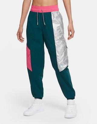 Jordan Nike Urban MTN logo pants in teal