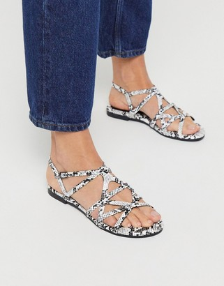 Xti multi strap flat sandals in snake