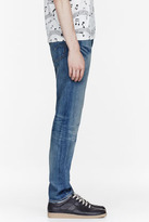 Levi's shredded and tapered 508 jeans