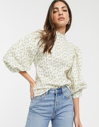 ASOS DESIGN high neck top with volume short sleeve in floral print