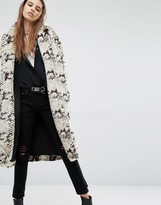 Religion Faux Fur Coat In Python Print