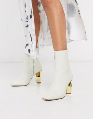 Kurt Geiger Daxon heeled ankle boot with gold heel in white leather
