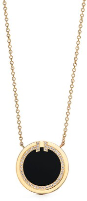 Tiffany & Co. T diamond and black onyx circle pendant in 18k gold
