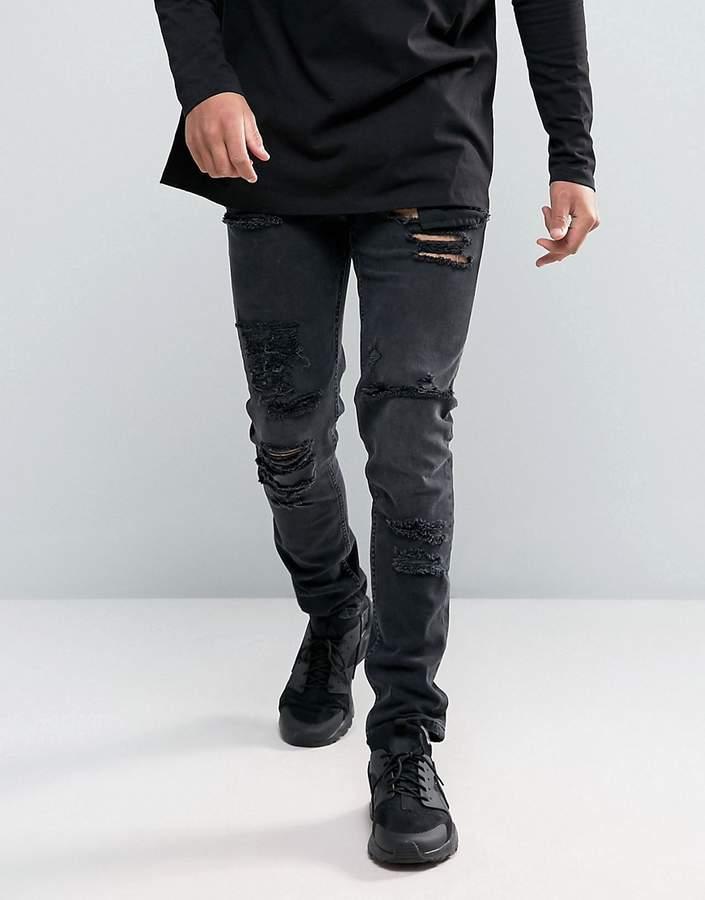 Asos DESIGN skinny jeans in 12.5oz with mega rips in washed black