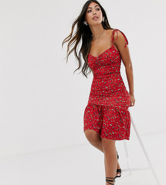 Asos DESIGN Petite ditsy print tiered mini dress in red