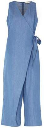 Paisie Cropped Denim Jumpsuit With Front Overlay & Side Tie In Denim Blue