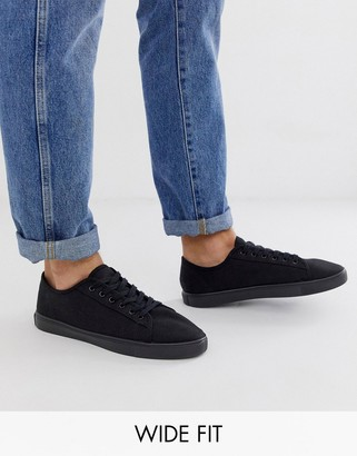 ASOS DESIGN Wide Fit trainers in black canvas